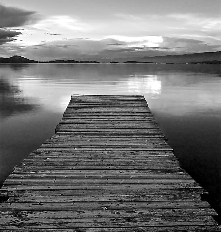 flathead-lake-dock-sunset-black-and-white-brian-stamm